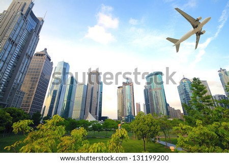 Shanghai,Aircraft is flying in the modern urban buildings