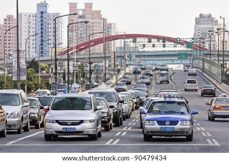 SHANGHAI - AUG 28: A traffic jam in Shanghai on Auf 28, 2009. A new auto-rental program will offer residents cars for short periods to reduce congestion.