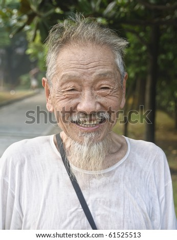 SHANGHAI - AUGUST 20:  Unidentified old Chinese man smiles at camera on August 20, 2009 in a park in Shanghai, China.  He is one of the 140 million old people in China.