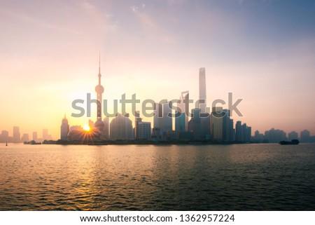 Shanghai, China city skyline during sunrise on the Huangpu River. #1362957224