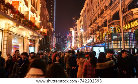 Shanghai, CHINA - DECEMBER 24, 2013 : Crowd on Nanjing road in Downtown of Shanghai. The area is the main shopping district of the city and one of the world's busiest shopping streets.