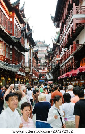 SHANGHAI, CHINA - JUNE 3, 2007: many tourist on Old Street in Old City of Shanghai, China. Old City of Shanghai , also formerly known as the Chinese city, is the traditional urban core of Shanghai.