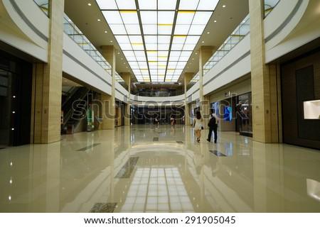 SHANGHAI, CHINA - June 30st. 2015. Luxury shopping mall interior. Multi luxury brand inside.Just the international labor day June 30st. 2015 Shanghai, China