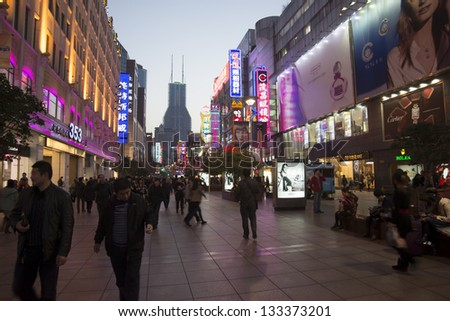 SHANGHAI, CHINA - MARCH 6: Nanjing Road street night view on March 6, 2013 in Shanghai, China of Nanjing Road is 6km long as the world's longest shopping district with 2M visitors daily.