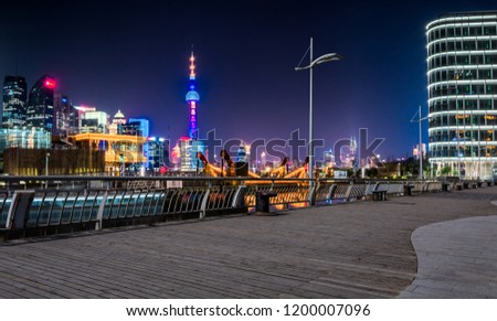 SHANGHAI, CHINA - MARCH 25: Pudong district view from The Bund waterfront area on March 25, 2016 in Shanghai, China. Pudong is a district of Shanghai, located east of the Huangpu River. #1200007096
