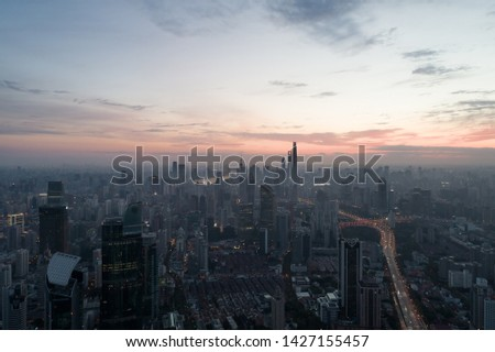 Shanghai, China - Oct 19, 2018: Aerial view of business area and cityscape in the dawn, West Nanjing Road, Jing` an district, Shanghai #1427155457
