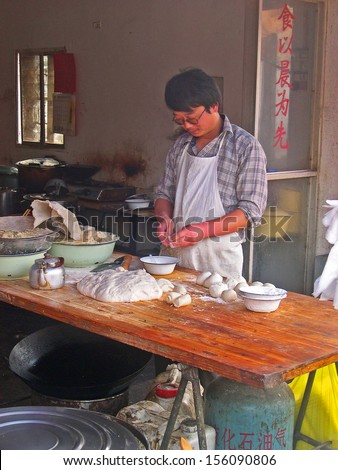 SHANGHAI, CHINA � OCTOBER 30: man preparing pasta for local restaurants. The ancient village is a Shanghai tourist attraction with 100000 visitors per year. October 30, 2004 Luzhi, China.