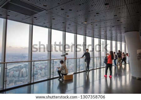 Shanghai, China: September 26, 2018: Tourists at the Shanghai Tower observing the Shanghai cityscape. Shanghai is the largest city in China. #1307358706
