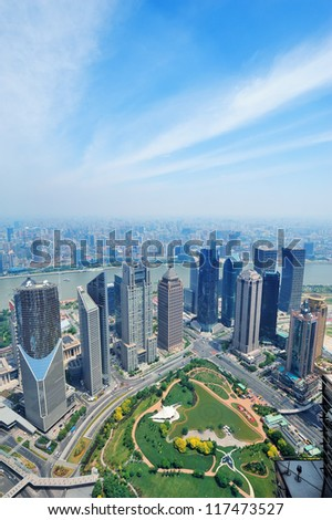Shanghai city aerial view in the day with blue sky and cloud