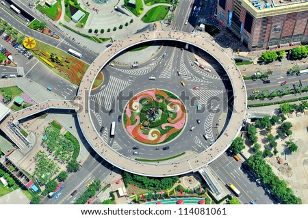 Shanghai city aerial view with street roundabout.