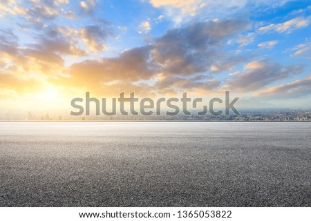 Shanghai city skyline and asphalt race track ground at sunrise,high angle view #1365053822