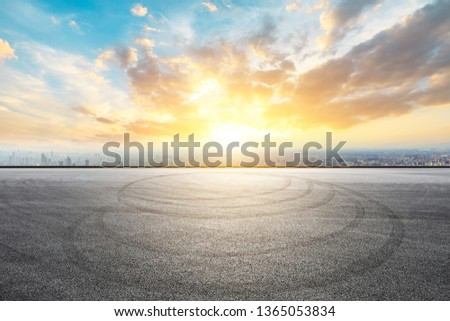 Shanghai city skyline and asphalt race track ground at sunrise,high angle view #1365053834