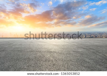 Shanghai city skyline and asphalt race track ground at sunrise,high angle view