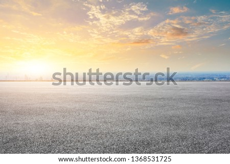 Shanghai city skyline and asphalt race track ground scenery at sunrise #1368531725