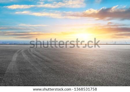 Shanghai city skyline and asphalt race track ground scenery at sunrise #1368531758