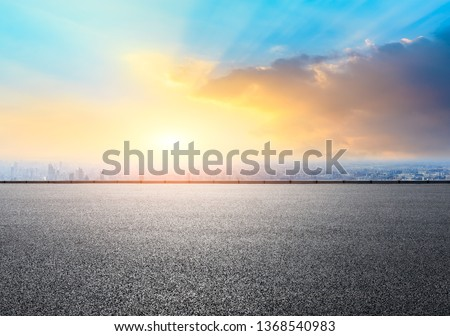 Shanghai city skyline and empty asphalt road ground scenery at sunrise