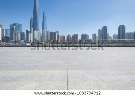 shanghai cityscape with empty granite brick floor on huangpu riverside #1083794912