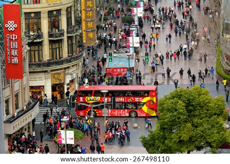 SHANGHAI, CN - MAR 17 2015:Visitors at Nanjing Road. It is the main shopping street of Shanghai, China, and is one of the world\'s busiest shopping streets.