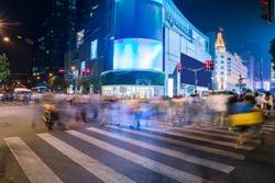 shanghai crossing at night. Night Shopping. Long exposure, blurred crowd.