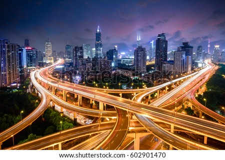 Shanghai elevated road junction and interchange overpass at night, Shanghai China #602901470