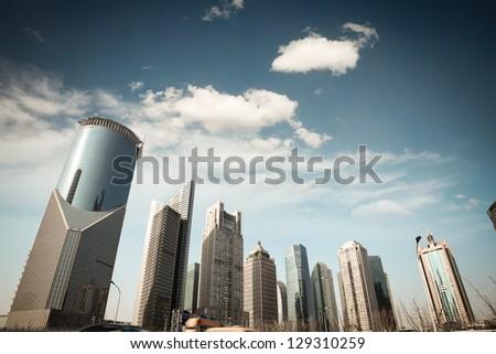 shanghai financial center skyline against a blue sky