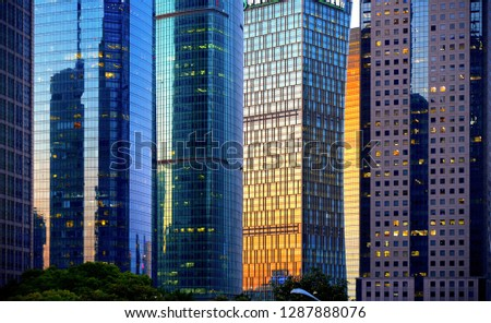 shanghai futuristic modern architecture and reflections on windows with sunset warm light. Skyline and great patterns of skyscrapers in financial district Pudong Shanghai, China #1287888076