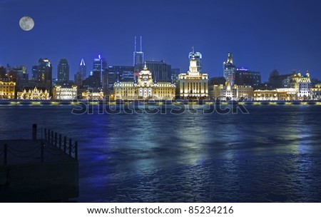 shanghai historic bund night view with a moon
