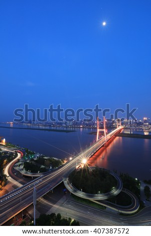 shanghai interchange overpass and elevated road in nightfall #407387572