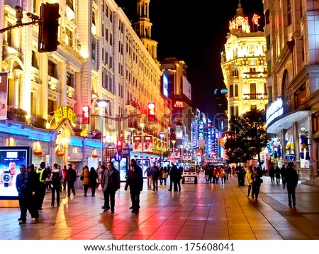 SHANGHAI JANUARY 21: Tourists at the famous shopping street, Nanjing road,  in Shanghai, China on Jan 21, 2014. Nanjing Road is one of the world\'s busiest shopping streets.