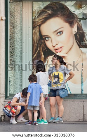 SHANGHAI-JUNE 5, 2014. Outdoor advertising. China\'s outdoor advertising market has grown annually more than 23% since 2000, versus 17% for the overall ad market, 14% for TV and 16% for newspapers.