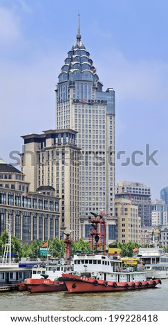 SHANGHAI-JUNE 5, 2014. The ICBC (Industrial and Commercial Bank) building, colonial architecture at Bund boulevard. Shanghai houses one of the world\'??s greatest collections of art deco architecture.