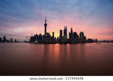 shanghai morning over colorful cloud and peaceful huangpu river