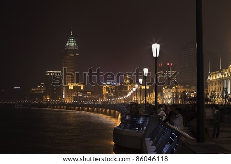 "SHANGHAI - NOV. 20: The Shanghai Bund waterfront area at nighttime on Nov. 20, 2010. The word ""bund"" means an embankment. It comes from the Hindi-Urdu word band, which has Persian origins."
