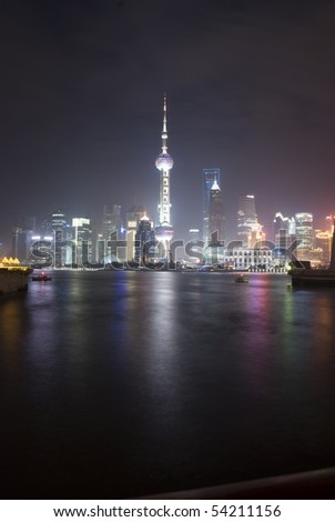 SHANGHAI, PEOPLE'S REPUBLIC OF CHINA - MAY 7: Shanghai skyline with the Pearl Tower lightened in the national colors during EXPO 2010 on May 7, 2010 in Shanghai, People's Republic of China.