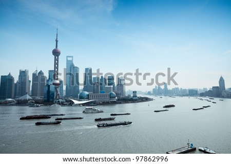 shanghai pudong skyline and busy huangpu river