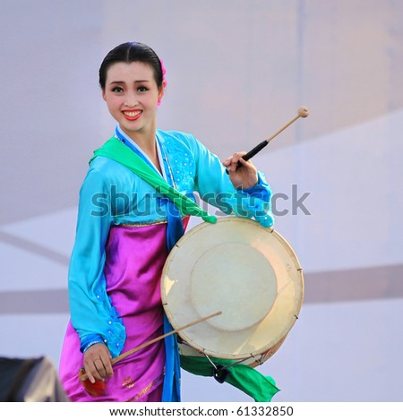 SHANGHAI - SEP 06: Artist from the Pyongyang Arts Troupe performs on stage during the DPRK National Pavilion Day celebrations at Shanghai World Expo 2010 on SEP 06, 2010 in Shanghai, China
