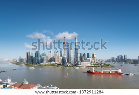 shanghai skyline and cityscape, large ship on the beautiful huangpu river #1372911284
