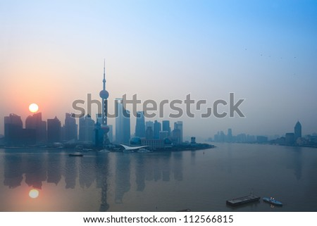 shanghai skyline and reflection in sunrise