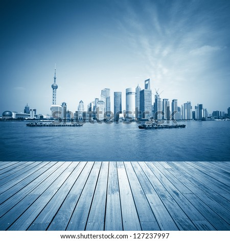 shanghai skyline and wooden floor with blue tone,beautiful scenery of the huangpu river.