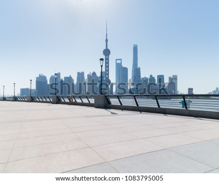 shanghai skyline in daytime, empty floor and railings on huangpu riverside #1083795005
