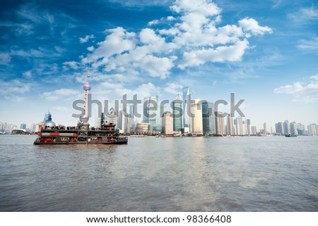 shanghai skyline in daytime,lujiazui finance and trade zone against a blue sky