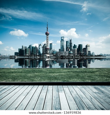 shanghai skyline with reflection and wooden floor and lawn