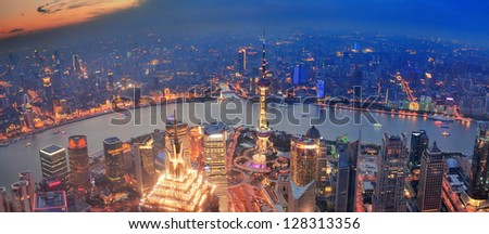 Shanghai sunset aerial view with urban architecture and river
