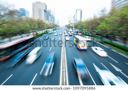 Shanghai - the blurred scene of the traffic movement in the daytime #1097095886