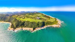 Shanqin Bay, Wanning County, Hainan Island, a Seaside Golf Course Built on a Rolling Land that Overlooks the South China Sea. Aerial View