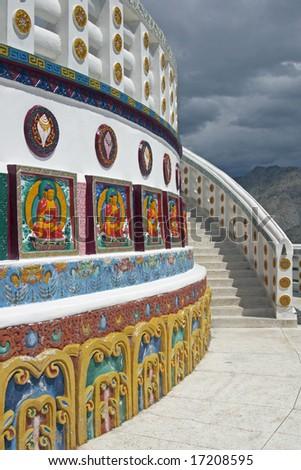Shanti Stupa. White Buddhist monument decorated with brightly painted murals. Leh, Ladakh, India
