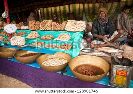 SHANTINIKETAN, INDIA - DECEMBER 25: A halwai or sweet maker makes sweets for sale in the annual Poush Mela fair on December 25, 2012 in Shantiniketan, West Bengal, India.