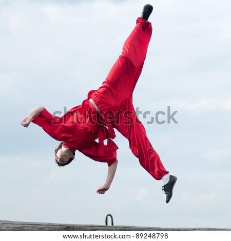 Shaolin warriors wushoo man in red practice martial art outdoor. Kung fu - Shutterstock ID 89248798