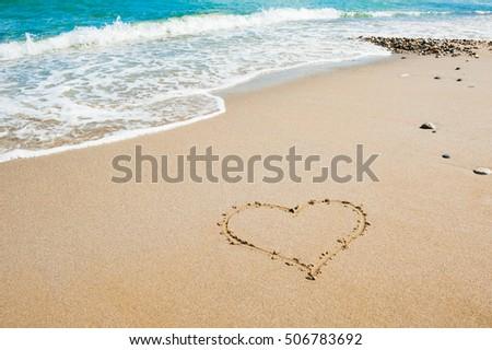 shape of heart on the beach ...