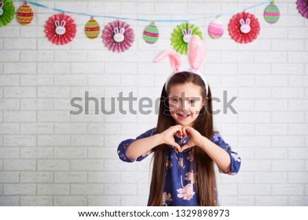 Shape of the heart with child's hands